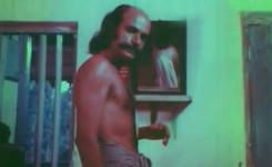 Bharat Gopy as Tablist Ayyappan in Yavanika